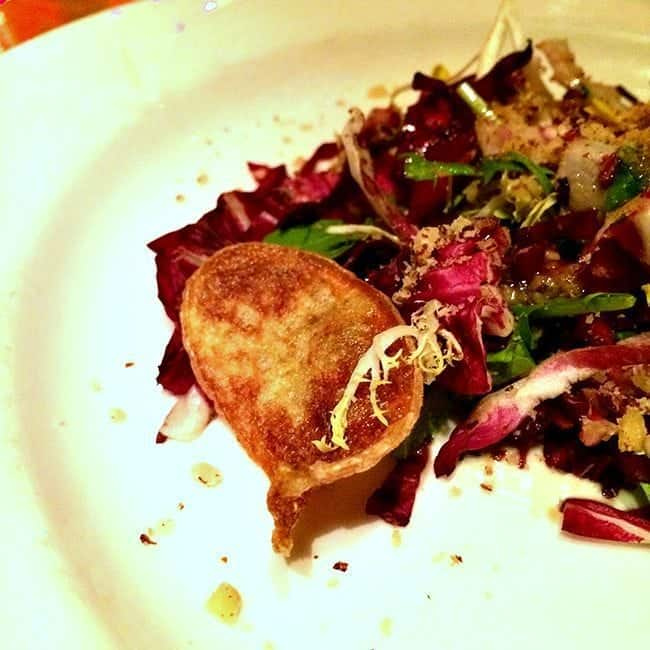 a plate of crispy endive, radicchio and frisee salad