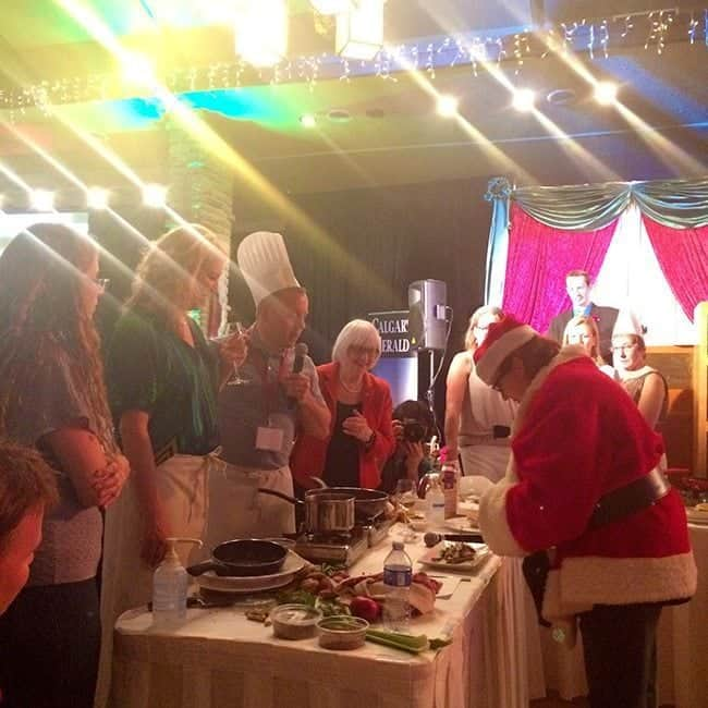 Santa chef in the table of presentation with some participants