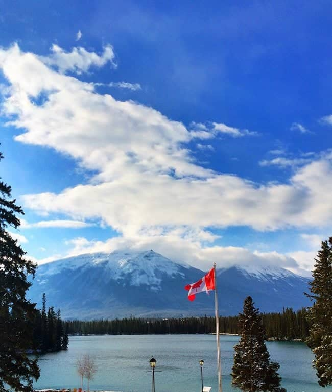 amazing mountain scenery with Canadian flag