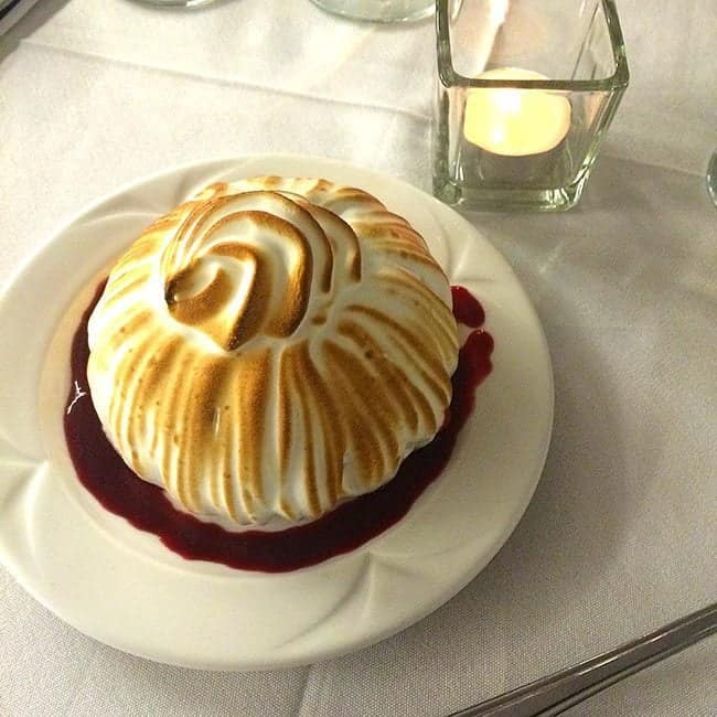 Top down shop of mini Baked Alaska in a white plate