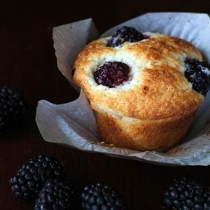 Lemon Blackberry Muffins with Muffin Liner on Dark Background with fresh Blackberry