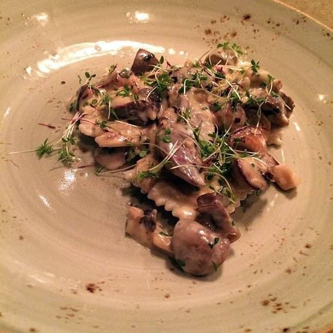 Four Whistle Farms goose confit with sauteed mushrooms & onion cream, sunchokeravioli