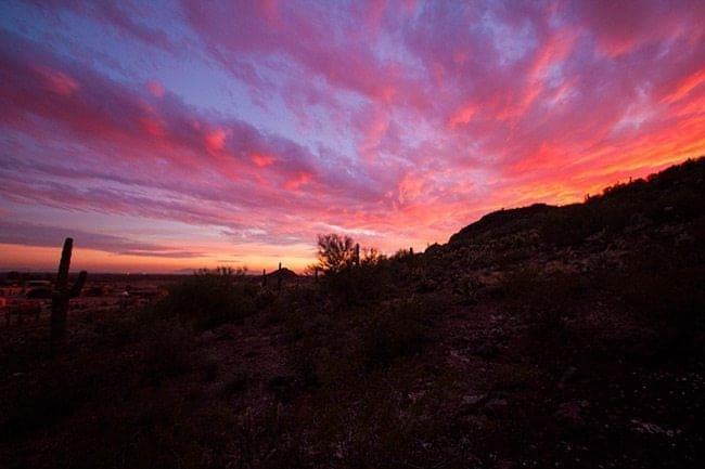 southwest view of 360 sunset with redish orange sky