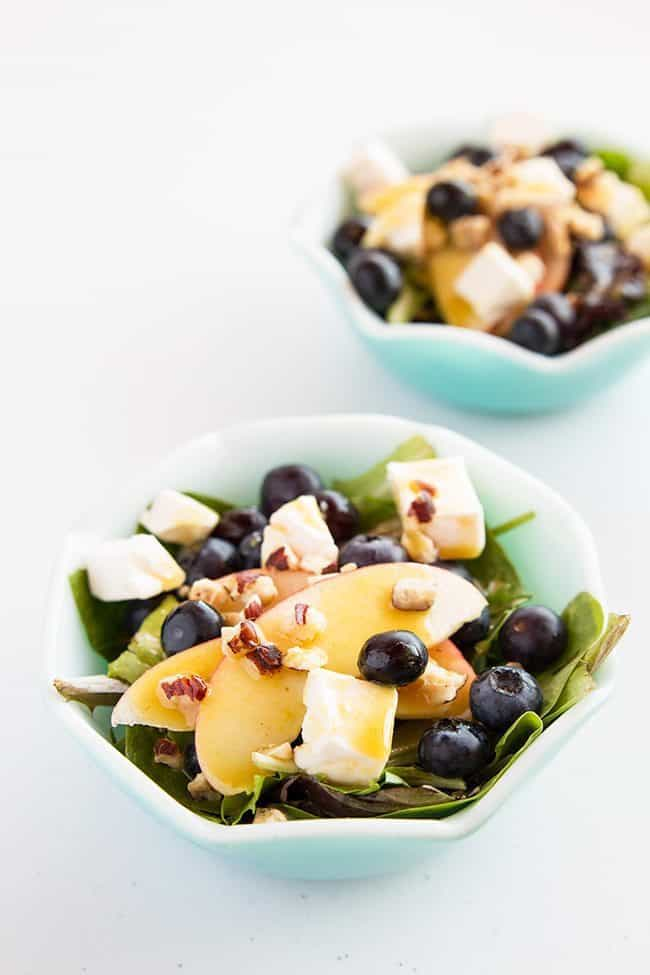 Mustard vinaigrette topped with apples, blueberries and Swiss cheese