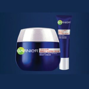 Garnier Ultra-Lift Miracle Sleeping Night Cream in Blue Background