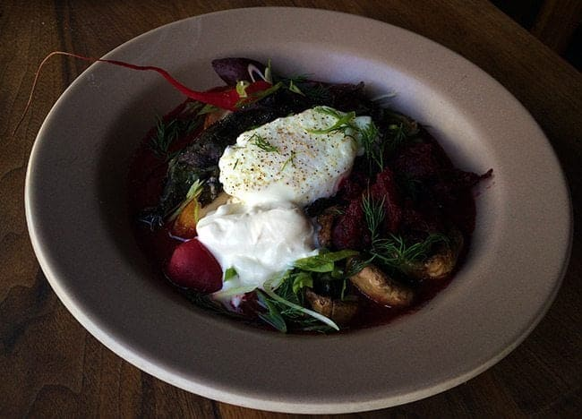 Braised Bacon with stewed beets, mushrooms and poached egg