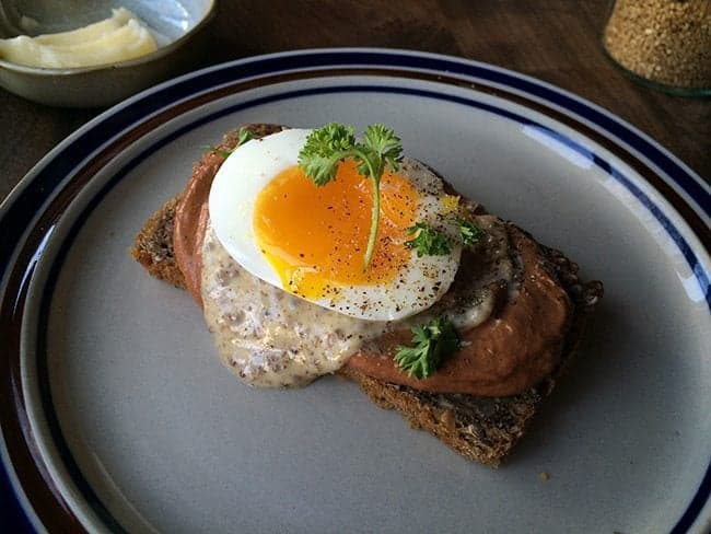 chicken liver pate with yolky egg in a plate