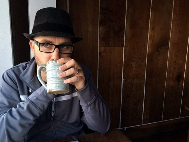 Man sitting while drinking a strong coffee from mug in the Bar Tartine in San Francisco