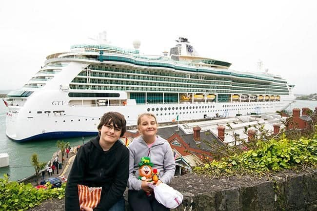 The kids in front of the RCI Brilliance of the Seas docked in Cobh, Ireland.
