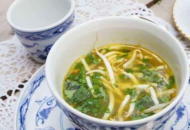 soup in a blue Pyrex soup bowl set