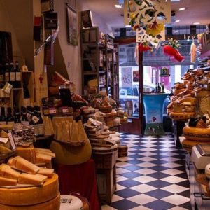 store with lots of different kinds of cheese