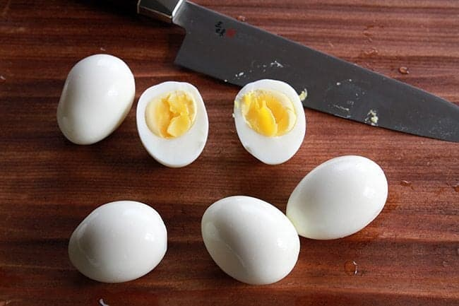 Perfect Hard Boiled Eggs and a knife on table