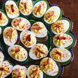 close up Bacon Deviled Eggs in a retro carnival glass deviled egg plate