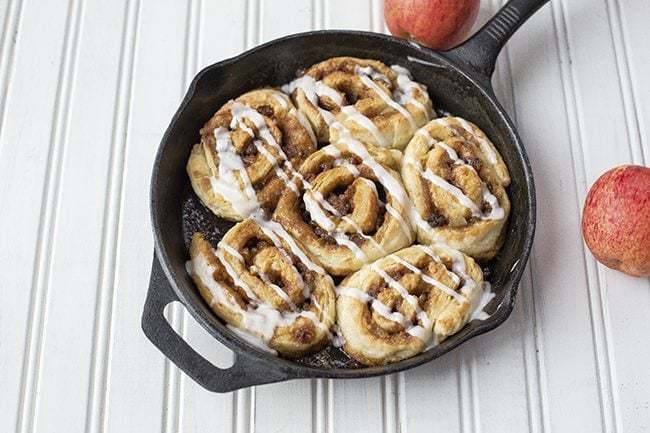 6 pieces Apple Pie Cinnamon Buns in Skillet on white background