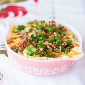 Crock Pot Mashed Potatoes topped with diced bacon, shredded cheese and chopped green onions