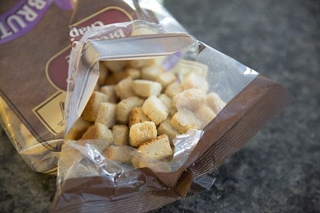 a pack of croutons for Apple Sausage Crockpot Stuffing