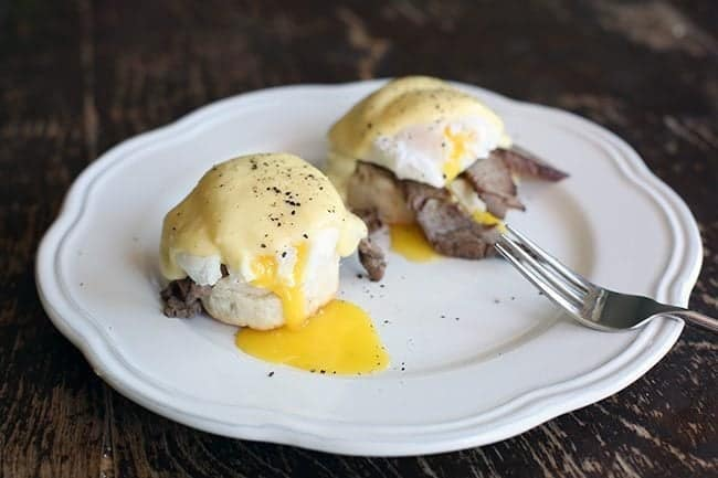 Steak n' Eggs Benedict with Buttermilk Biscuits in a White Plate ready to be Enjoy!