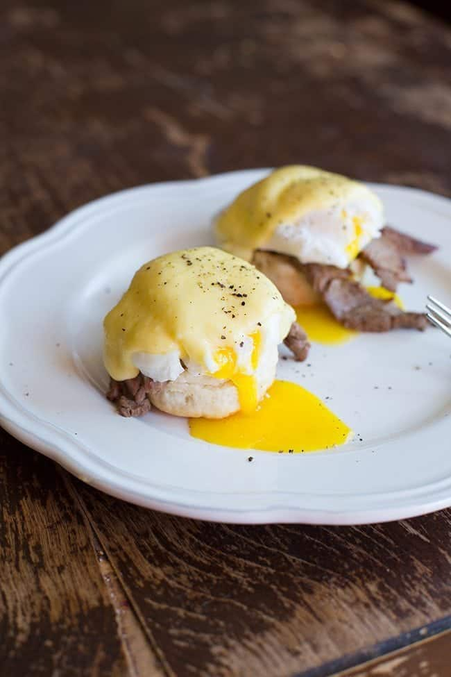 Buttermilk Biscuit with steak on one half, topped with a poached egg and Hollandaise Sauce