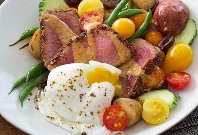 Chia Crusted Nicoise Salad Square in a white plate with poached egg