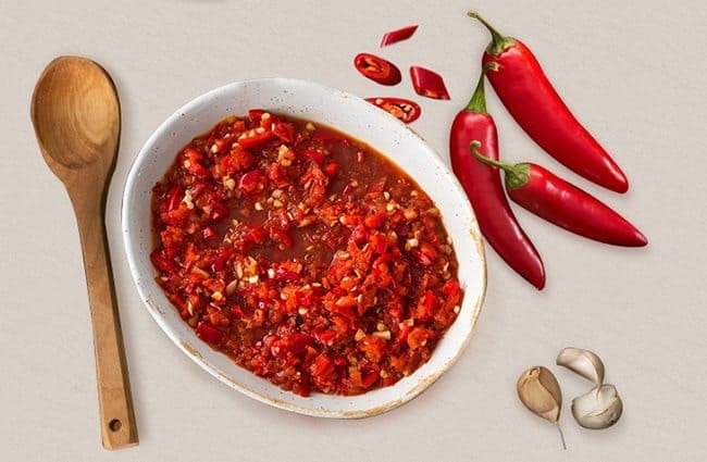 Heat-and-Tang_SpoonwithPeppers_with_Background