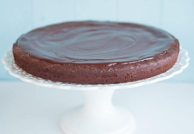 Flourless Chocolate Cake in a white cake stand