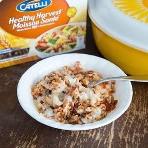 Macaroni Chop Suey in a White Bowl, Box of Catelli Macaroni and large yellow casserole dish at the back