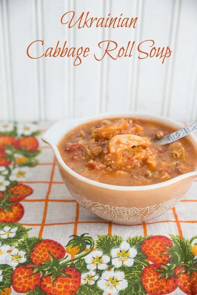 Ukrainian Cabbage Roll Soup in a peach colored Pyrex bowl with a spoon in it
