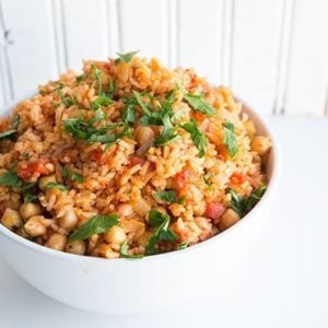 Vegan Smoky Spanish Rice & Chickpeas in a white bowl on white background