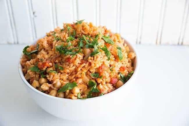Vegan Smoky Spanish Rice & Chickpeas in a white bowl on white background