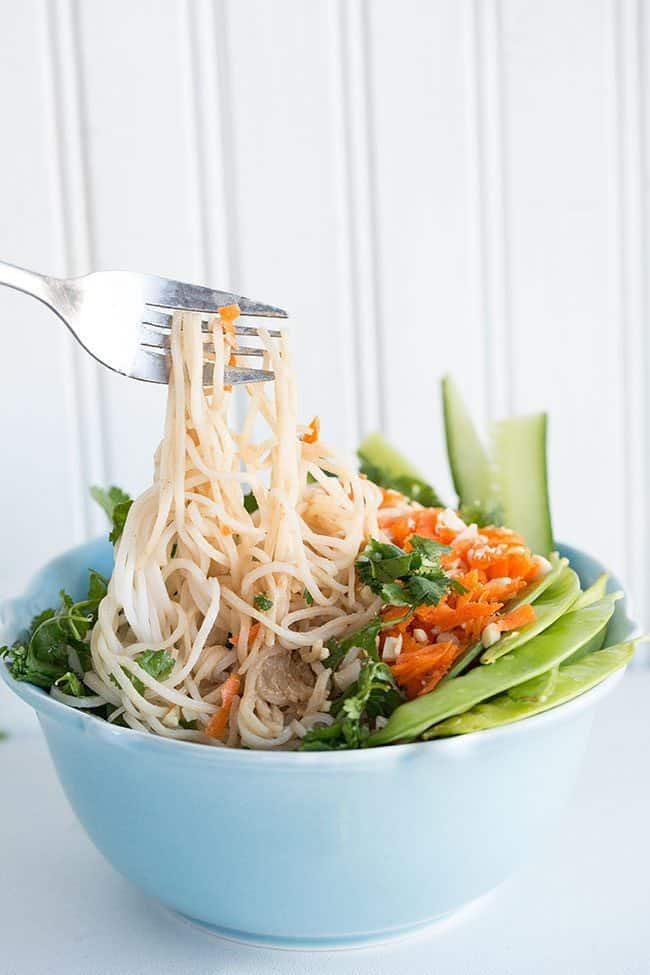 getting some noodle from Fresh Thai Peanut Vegetable Noodle Bowl using a fork