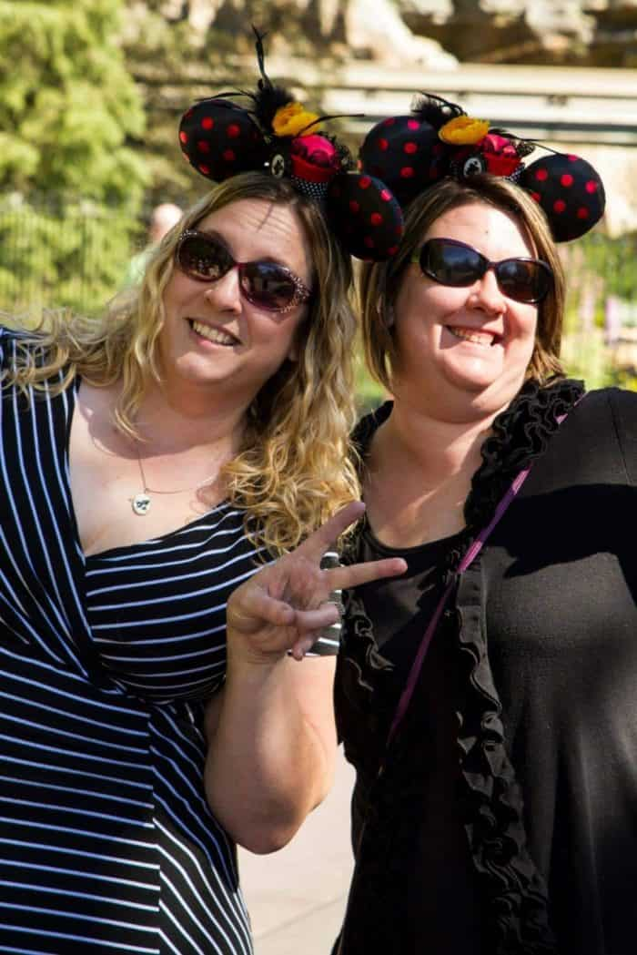 two women wearing Minnie mouse hairdress