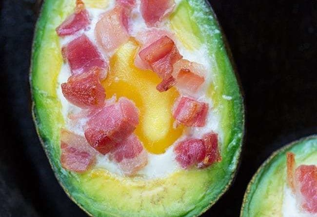 close up eggs baked avocado with pancetta on top