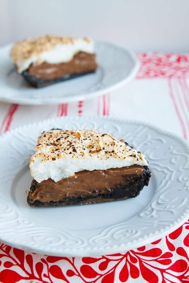 Close up Slice of Chocolate Pie with graham cracker crust and white meringue on top