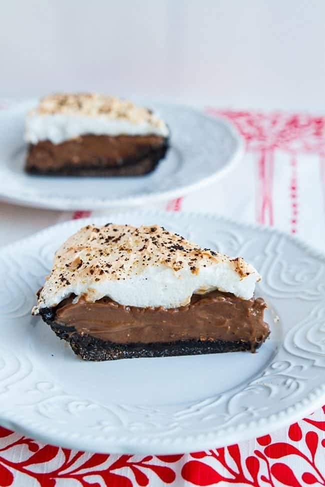 Slices of Chocolate Flapper Pie with graham cracker crust in white dessert plates