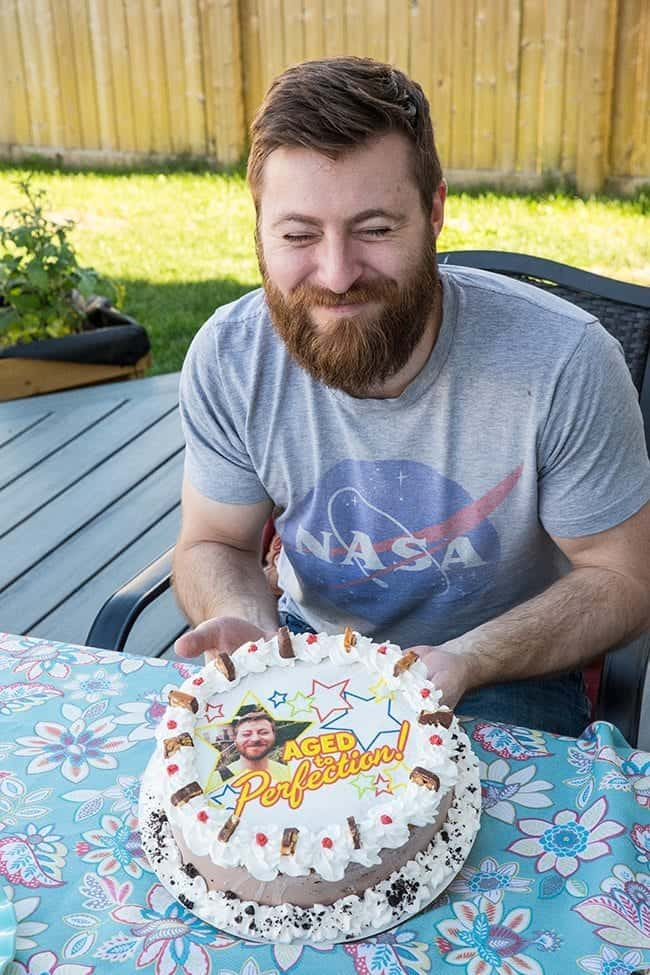 man holding his photo cake