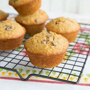 Classic Oatmeal Raisin Muffins on a black cooling rack