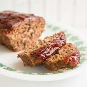 close up of sliced Retro Sweet & Sour Meatloaf in a white plate with white background