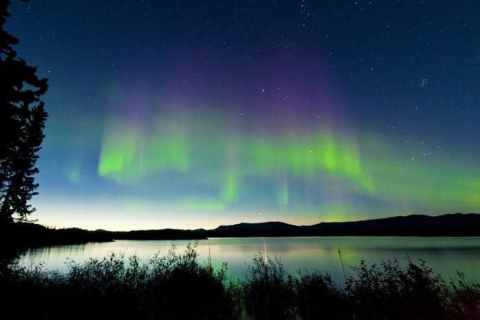 Dancing Northern lights Aurora borealis in summer