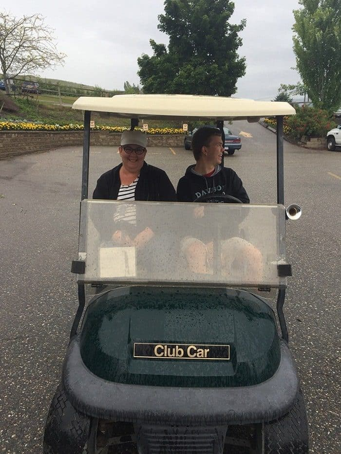 riding in a private golf cart