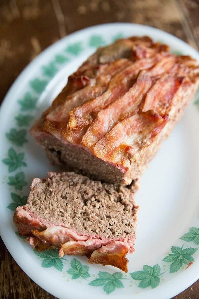 Bacon Topped Mozzarella Meatloaf on a green ivy pattern plate