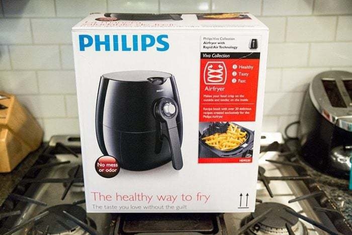 box po Philips brand airfryer on top of stove