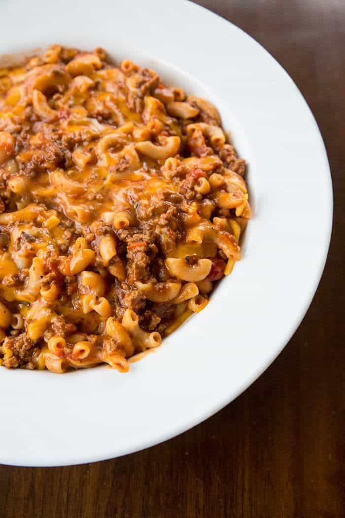 Classic American Goulash in a large white bowl