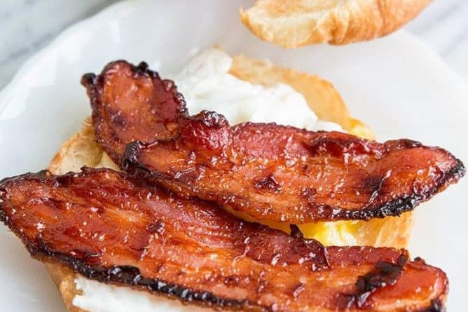 BBQ Glazed Bacon & Eggs in slices of Croissants on a marble background