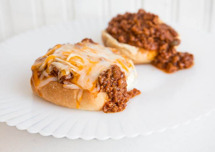 2 servings of buns topped with Sloppy Joes and cheese