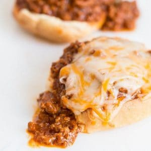 2 pieces of buns with Sloppy Joes and cheese on top