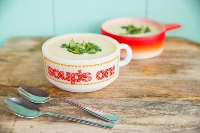 Potato leek soup on a soup bowls, 2 spoons on side