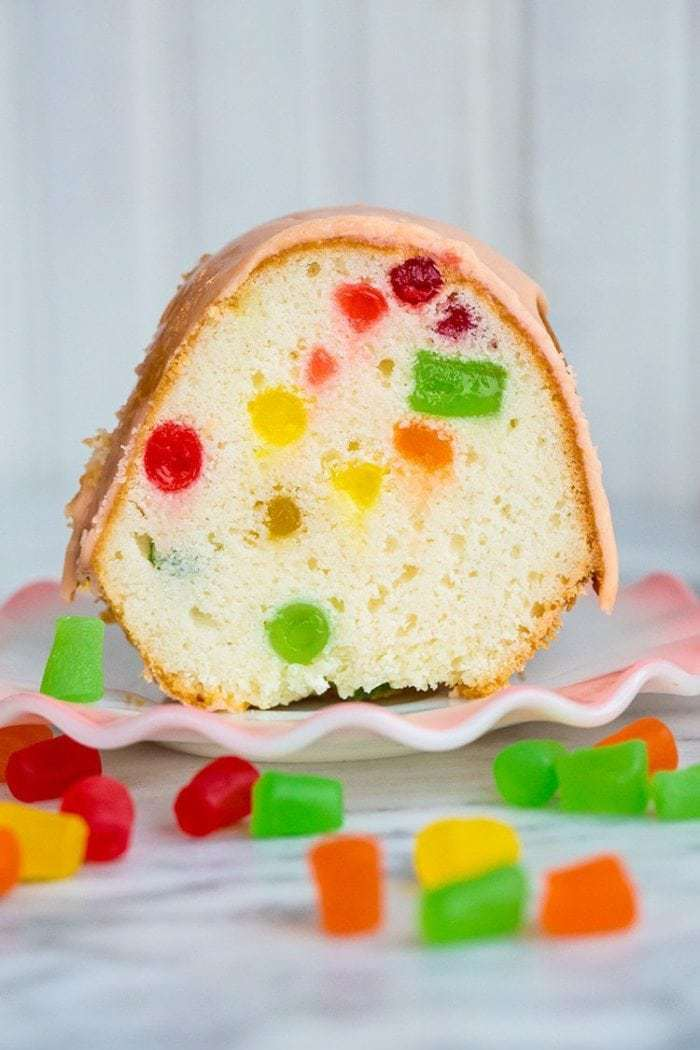 Decadent and delicious Gumdrop Cake! Perfect for your next party or holiday gathering! from @kitchenmagpie. #christmas #recipe #cake #gumdrop #dessert