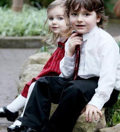 two cute kids sitting