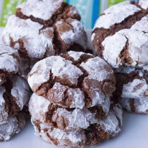 close up stacks of Classic Chocolate Crinkle Cookies in a white plate