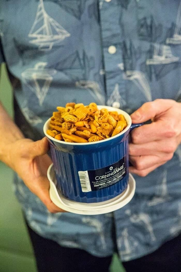Phil from Baconhound holding a blue CorningWare Meal Mug with Homemade Nuts & Bolts